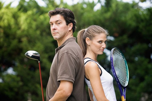 View of a man and woman with sports equipments. : Stock Photo