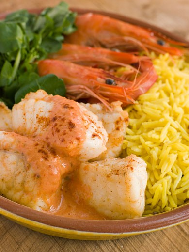 Saute of Monkfish Prawns and Rice with Pimento Cream : Stock Photo