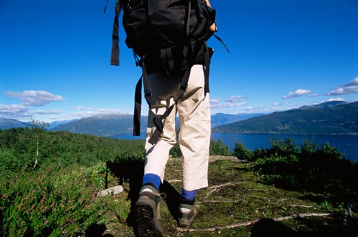 Woman's legs outdoors while hiking in scenic location : Stock Photo