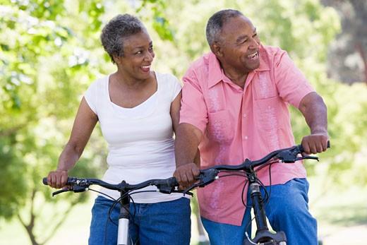 Stock Photo: 1799R-22598 Senior couple on bicycles