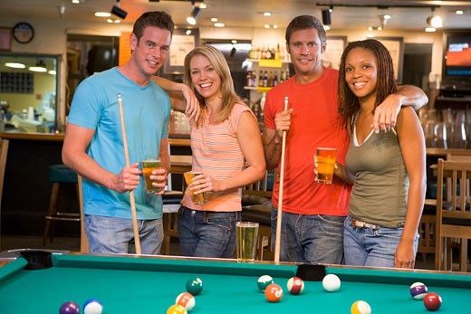 Stock Photo: 1799R-22672 Friends at a pool hall