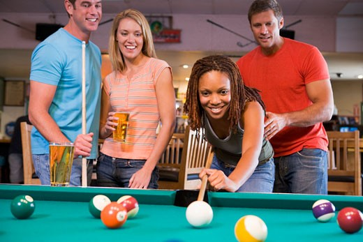 Stock Photo: 1799R-22677 Friends playing pool