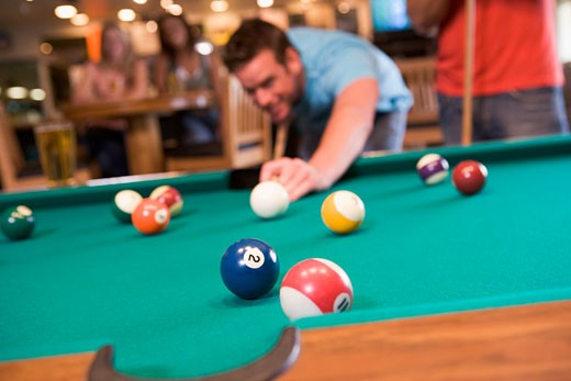 Stock Photo: 1799R-22679 Man playing pool