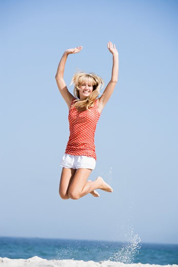 Stock Photo: 1799R-23512 Woman jumping on a beach
