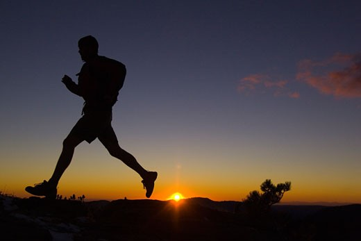 Silhouette of a man running at sunset, Lake Tahoe, California, USA : Stock Photo