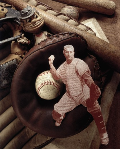 Close-up of a cutout of a baseball player with baseball memorabilia : Stock Photo