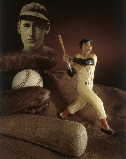 Close-up of a figurine of a baseball player with baseball memorabilia : Stock Photo