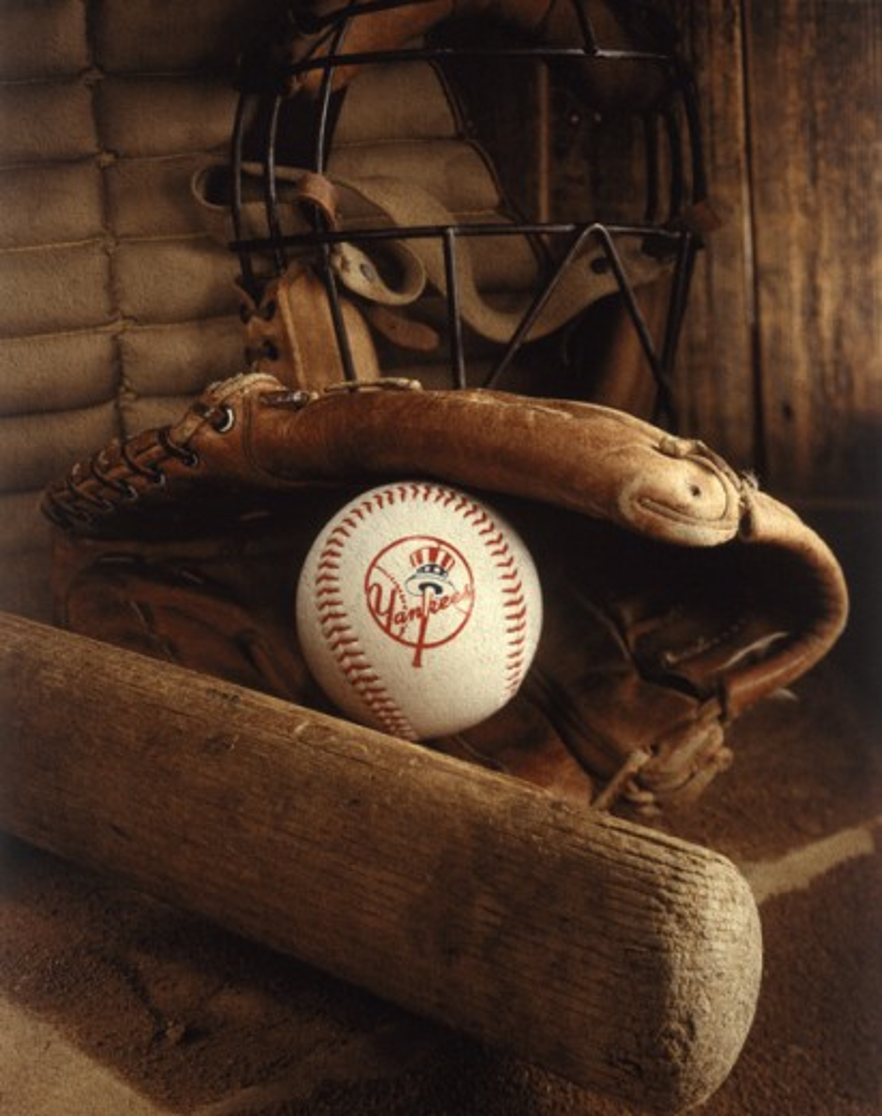 Close-up of a baseball bat and a baseball glove : Stock Photo
