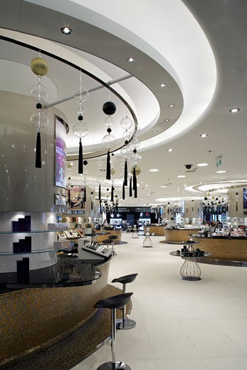 Stock Photo: 1801-1072 HARVEY NICHOLS DEPARTMENT STORE, KANYON SHOPPING MALL, ISTANBUL, TURKEY, INTERIOR OF THE MAKEUP AND COSMETICS AREA ON THE LOWER GROUND FLOOR, WITH CURVED DISPLAY WALL ON LEFTHAND SIDE., FOUR IV DESIGN
