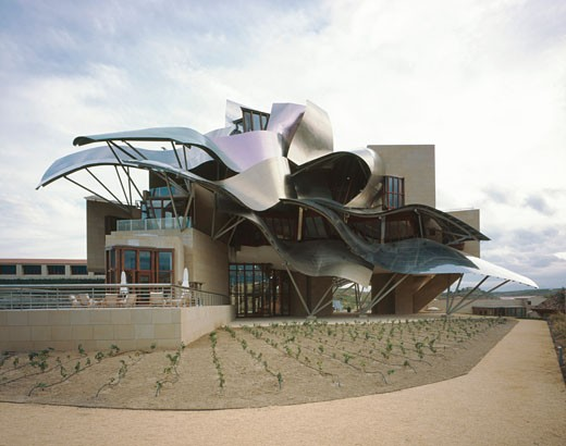 Stock Photo: 1801-11370 BODEGAS MARQUES DE RISCAL, ELCIEGO, ALAVA-BASQUE COUNTY, SPAIN, MORNING VIEW OF THE MAIN BUILDING WITH VINEYARDS, FRANK GEHRY