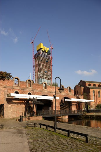 BEETHAM TOWER, 301 DEANSGATE, MANCHESTER, UNITED KINGDOM, BEETHAM TOWER UNDER CONSTRUCTION WITH RESTORED BRIDGES IN CASTLEFIELD, MANCHESTER., IAN SIMPSON ARCHITECTS : Stock Photo
