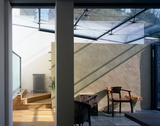 Stock Photo: 1801-25129 HOUSE EXTENSION, HAMPSTEAD, LONDON, UNITED KINGDOM, EXPOSED WALL AND TILED SLATE FLOOR OF DINING ROOM WITH GLASS ROOF, SANYA POLESCUK