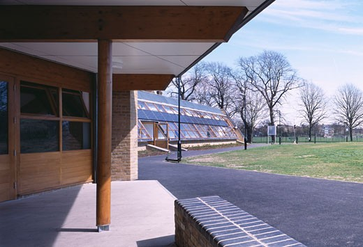 Stock Photo: 1801-25459 BURGESS PARK FOOTBALL PAVILION, BURGESS PARK, LONDON, SE5 CAMBERWELL, UNITED KINGDOM, UNDER CAFE CANOPY LOOKING ALONG SOUTH FACSDE, DAY, STUDIO E ARCHITECTS