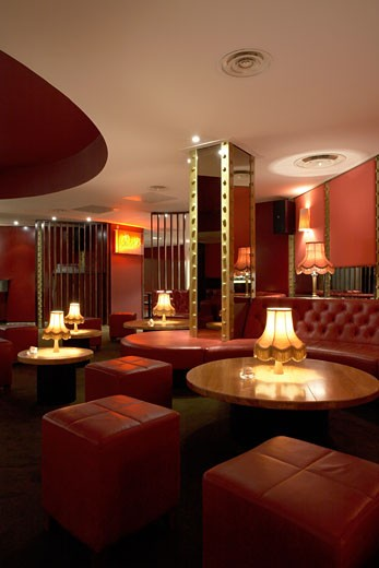 Stock Photo: 1801-27763 ALL STAR LANES, BLOOMSBURY PLACE, LONDON, WC1 BLOOMSBURY, UNITED KINGDOM, INTERIOR OF THE MAIN BAR AREA SHOWING RED LEATHER UNHOLISTERED SEATING, ARCHITECT UNKNOWN