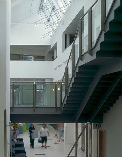 Runnymede CIVIC centre main stair landing to ground floor., Runnymede CIVIC Centre, Station Road, Addlestone, Surrey, United Kingdom, Feilden Clegg Architects : Stock Photo