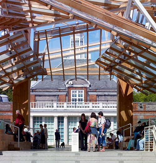 Stock Photo: 1801-31415 Serpentine gallery pavilion 2008 day front cropped pavilion and gallery and people., Serpentine Gallery Pavilion 2008, Kensington Gardens, London, W2 Paddington, United Kingdom, Frank Gehry