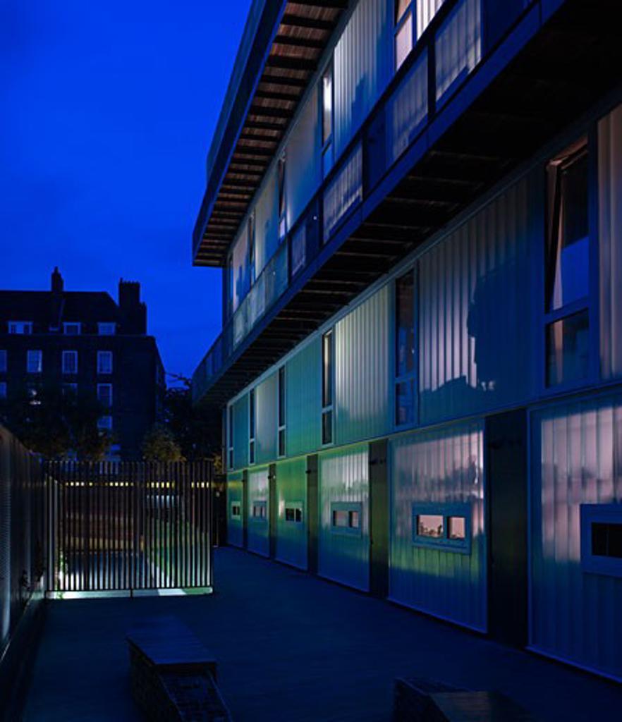 Dkh - residential development exterior dusk courtyard glass wall kitchen bedrooms walk ways., Dkh - Residential Development, Dog Kennell Hill, London, SE22 East Dulwich, United Kingdom, John Smart Architects : Stock Photo