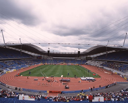 Stock Photo: 1801-3445 CITY OF MANCHESTER STADIUM, MANCHESTER, UNITED KINGDOM, STADIUM INTERIOR WITH ATHLETES FROM TEMPORARY STAND GENERAL VIEW, ARUP ASSOCIATES