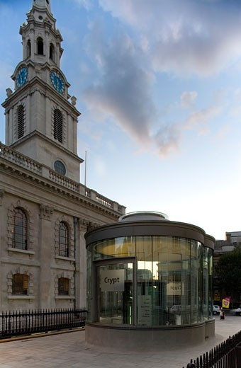 St Martins-in-the-fields, London, United Kingdom, Eric Parry, Church spire with glass entrance to the crypt. : Stock Photo