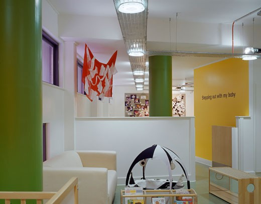 Stock Photo: 1801-37861 The Green Building, Manchester, United Kingdom, Terry Farrell and Partners, The green building nursery interior with colours.