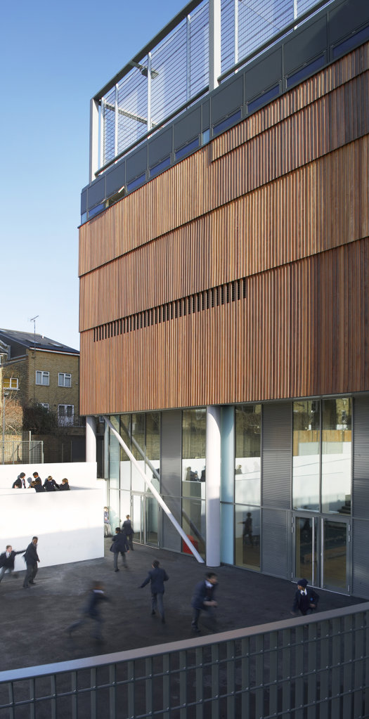 St Mary Magdalene Academy, London, United Kingdom, Feilden Clegg Bradley Architects, St mary magdalene academy view of building and playground. : Stock Photo