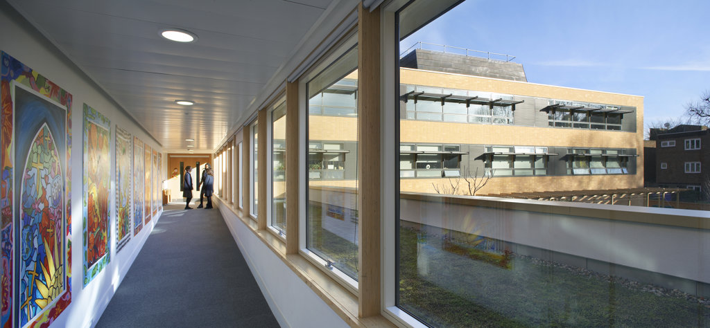 St Mary Magdalene Academy, London, United Kingdom, Feilden Clegg Bradley Architects, St mary magdalene academy internal corridor with view to exterior. : Stock Photo