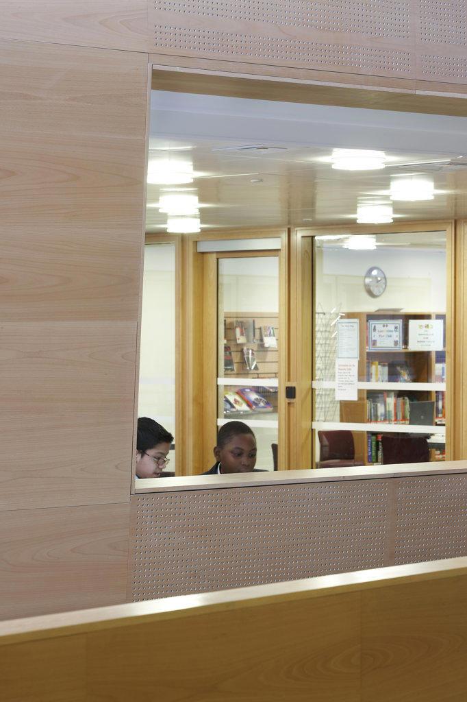 St Mary Magdalene Academy, London, United Kingdom, Feilden Clegg Bradley Architects, St mary magdalene academy view through hatch into office. : Stock Photo