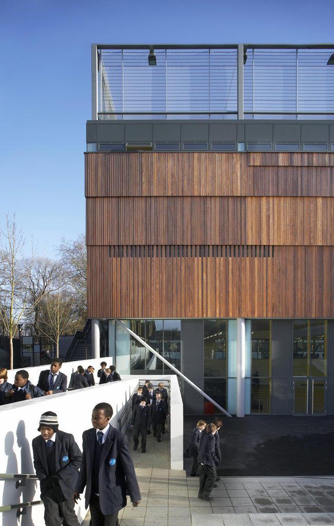 Stock Photo: 1801-38034 St Mary Magdalene Academy, London, United Kingdom, Feilden Clegg Bradley Architects, St mary magdalene academy pupils in courtyard.