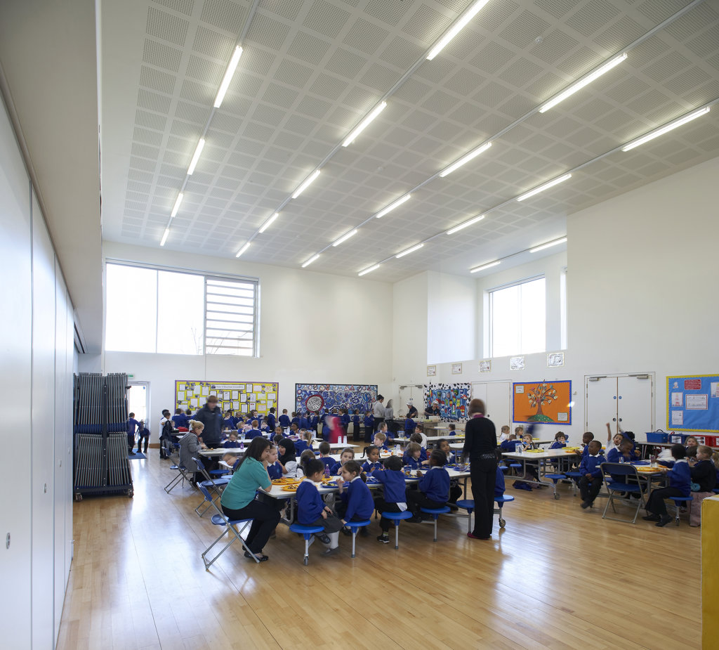 Stock Photo: 1801-38040 St Mary Magdalene Academy, London, United Kingdom, Feilden Clegg Bradley Architects, St mary magdalene academy class studying in hall.