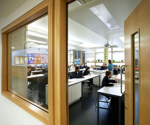 Stock Photo: 1801-38046 St Mary Magdalene Academy, London, United Kingdom, Feilden Clegg Bradley Architects, St mary magdalene academy view through open door into classroom.