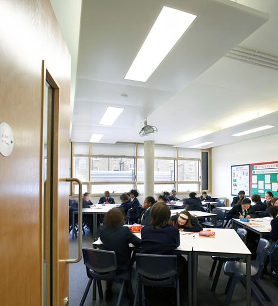 St Mary Magdalene Academy, London, United Kingdom, Feilden Clegg Bradley Architects, St mary magdalene academy view through open door into classroom. : Stock Photo