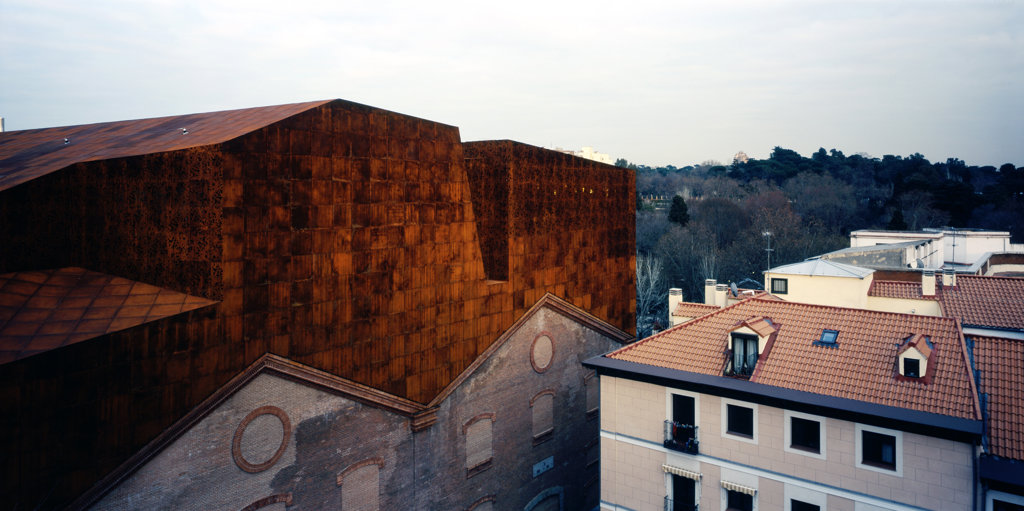 Caixa Forum Madrid, Madrid, Spain, Herzog & De Meuron, Caixa forum madrid evening shot looking towards the botanic garden. : Stock Photo