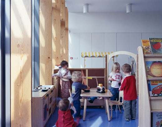 Surestart School, London, United Kingdom, John McAslan and Partners, Surestart school classroom with children near window light. : Stock Photo