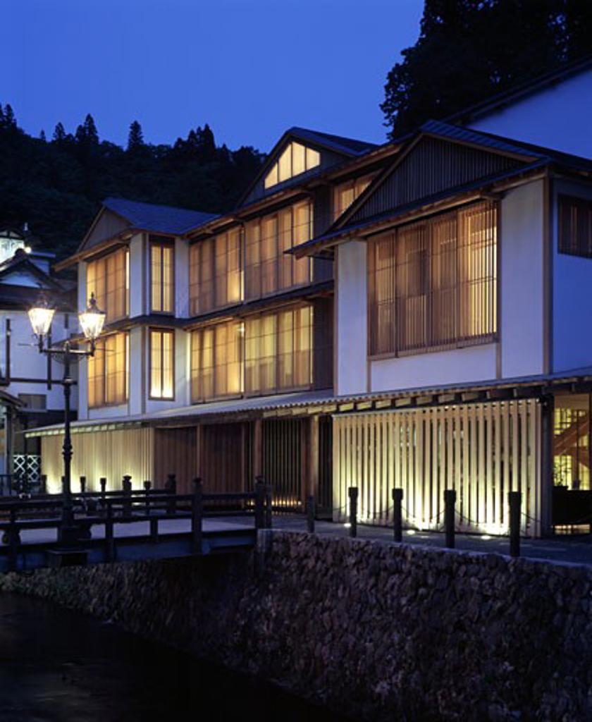 Ginzan Onsen Fujiya, Yamagata, Japan, Kengo Kuma & Associates, Ginzan onsen fujiya overall exterior view at twilight. : Stock Photo