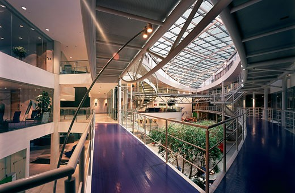 Stock Photo: 1801-44503 Pfizer UK Headquarters, Tadworth Walton Oaks, United Kingdom, Sheppard Robson, Pfizer UK headquarters atrium spiral staircase walkway handrail.