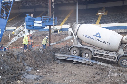 Wembley Stadium Demolition, Wembley, United Kingdom, Architect Unknown, Wembley stadium demolition concrete mixer. : Stock Photo