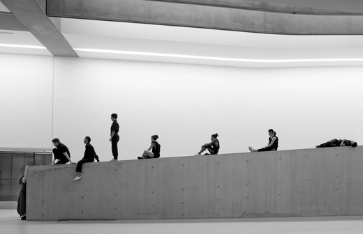Maxxi National Museum of 21st Century Arts, Rome, Italy, Zaha Hadid Architects, Dancers rehearsing for the opening show taking a break. : Stock Photo