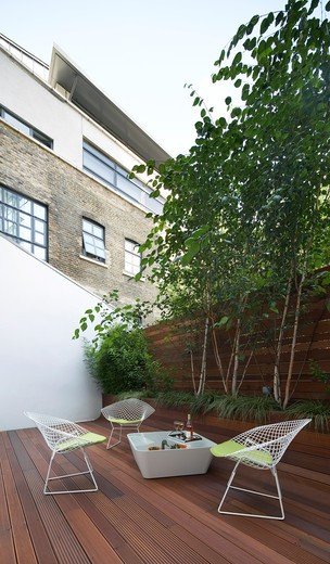 Stock Photo: 1801-53702 Private House  Ambience Contracts  London  2010  Decked Garden With Table And Chairs