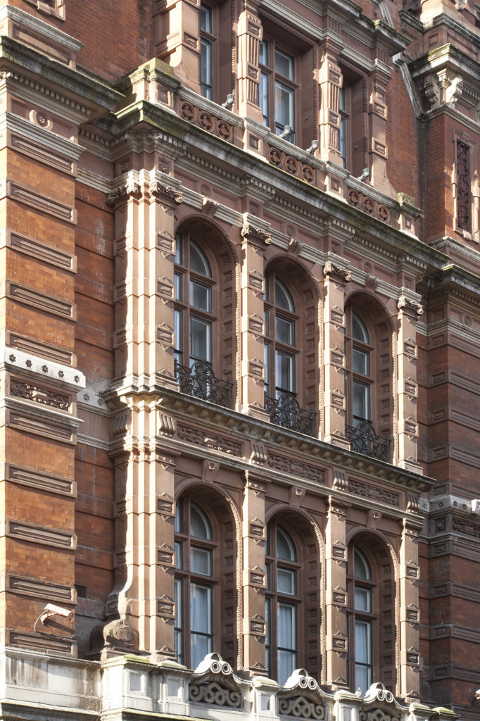 Stock Photo: 1801-55322 City Of London 2010  Former Great Eastern Hotel Now Andaz Liverpool Street  40 Liverpool Street  London  Detail For The Exterior Windows With Low Winter Light