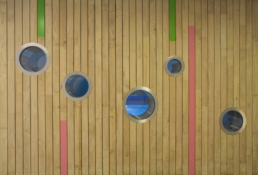 Stock Photo: 1801-59004 Tuke School, Haverstock Associates, London, 2010, Colourful Interior Timber Cladding With Portholes