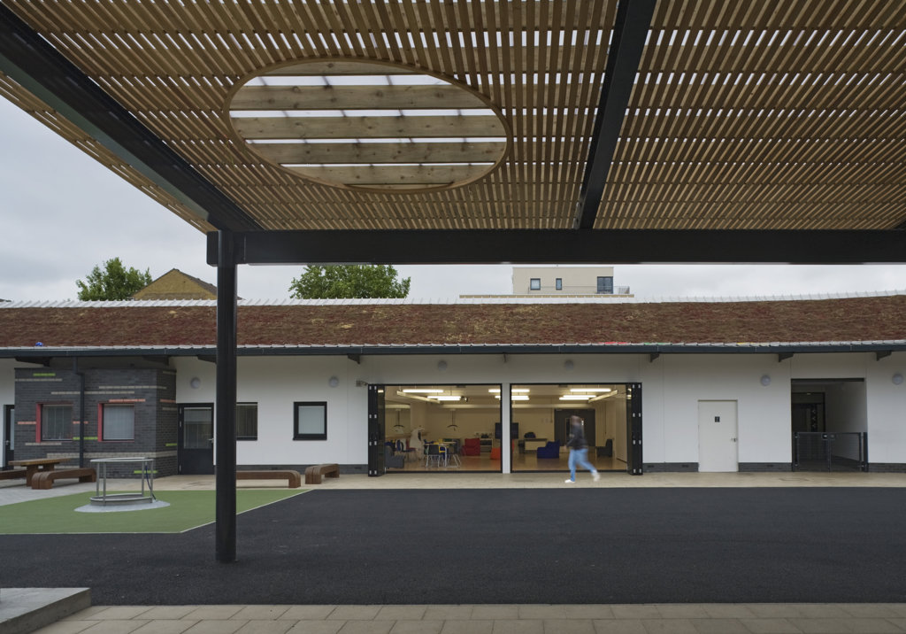 Stock Photo: 1801-59014 Tuke School, Haverstock Associates, London, 2010, View From Canopied Schoolyard Area To Classroom