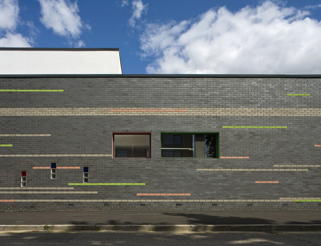 Tuke School, Haverstock Associates, London, 2010, Detail Of Exterior Glazed Brick And Colour Striped Facade : Stock Photo