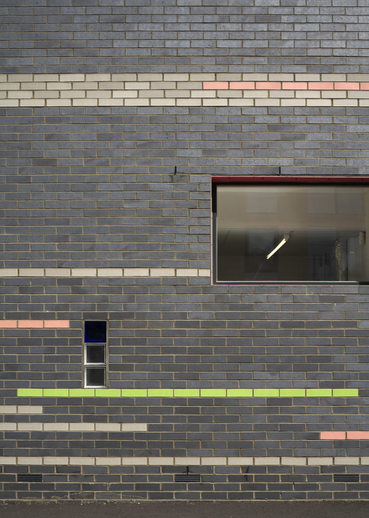 Stock Photo: 1801-59017 Tuke School, Haverstock Associates, London, 2010, Detail Of Exterior Glazed Brick And Colour Striped Facade With Windows
