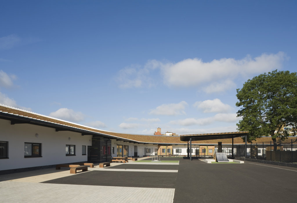 Stock Photo: 1801-59020 Tuke School, Haverstock Associates, London, 2010, General Elevation Of Exterior Schoolyard