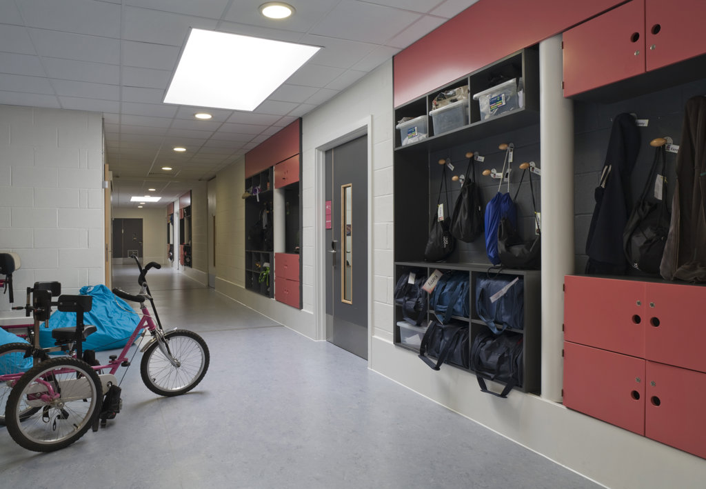 Stock Photo: 1801-59044 Tuke School, Haverstock Associates, London, 2010, Corridor View With Classroom Entrance And Coat Rack