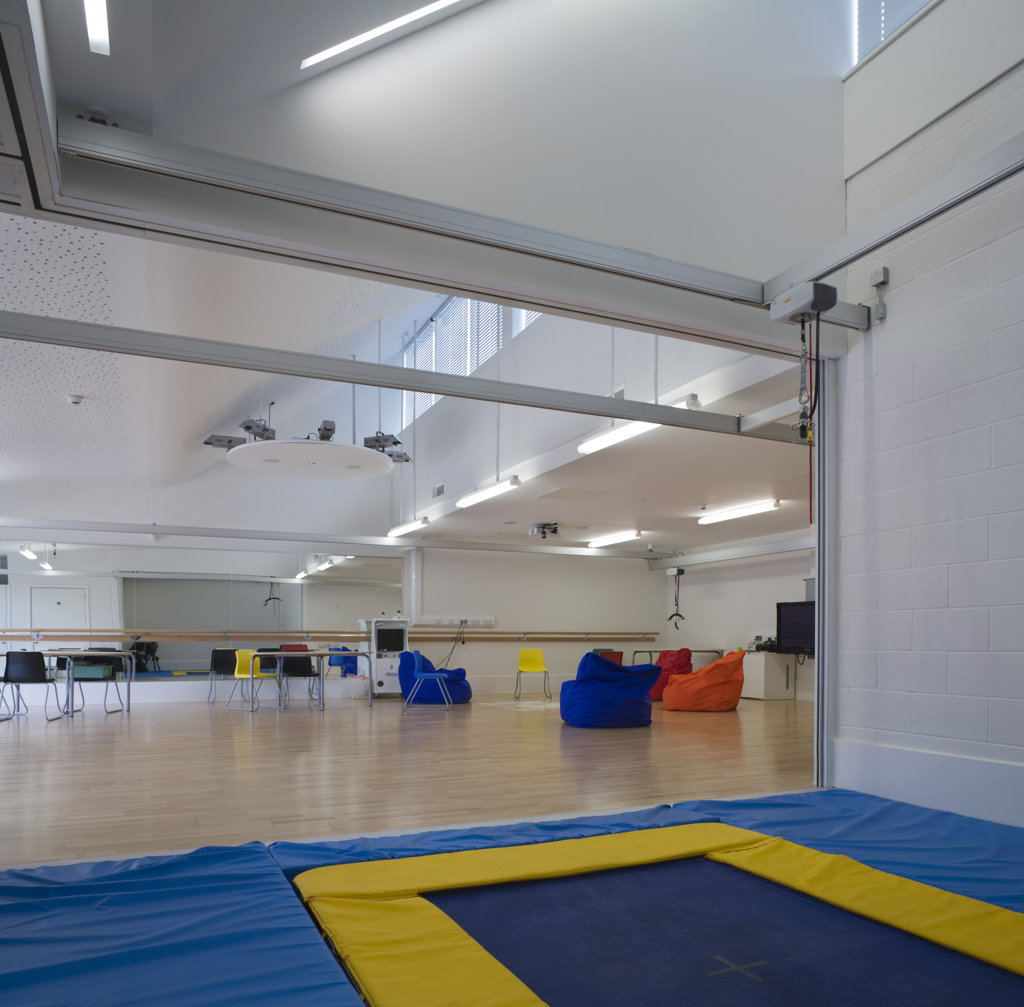 Stock Photo: 1801-59045 Tuke School, Haverstock Associates, London, 2010, Wide View Of Classroom And Integrated Trampoline Area