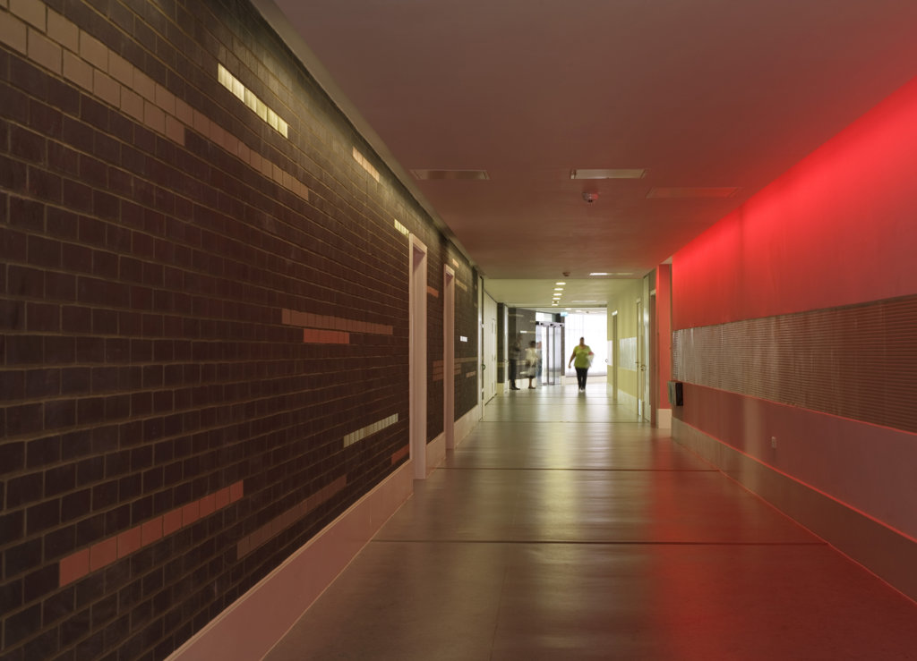 Stock Photo: 1801-59046 Tuke School, Haverstock Associates, London, 2010, View Of Corridor And Red Sensory Lights