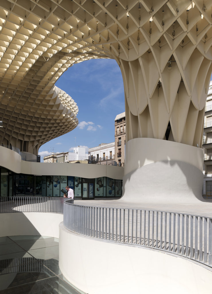 Stock Photo: 1801-62008 Metropol Parasol By J Mayer H Architects In Sevilla Spain. A Man And A Boy Looking Down Onto The Archeological Museum