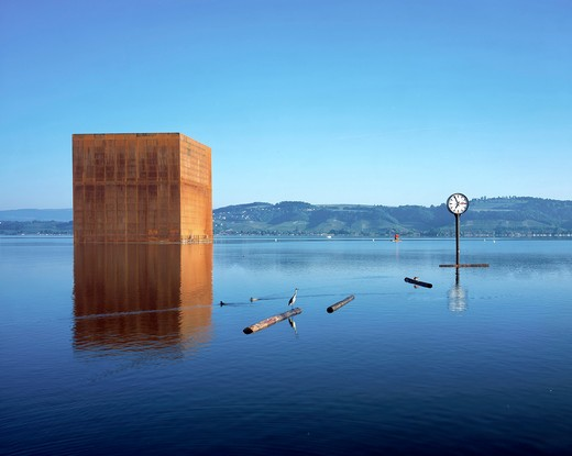 Stock Photo: 1801-64080 Morat Artplage The Monolith Early Morning On Lake Morat With Clock.