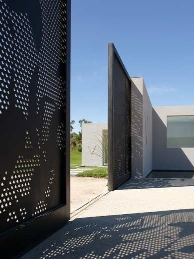 Villalagos Gatehouse Administration Building Perforated Steel Gates : Stock Photo